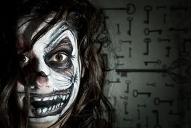 image of scary face  - Teenage girl with scary clown face painting - JPG