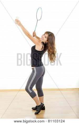 Young Fitness Woman Playing Badminton In Sweat Suit