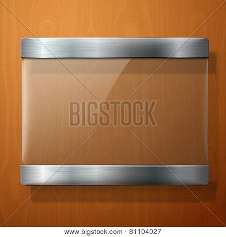 Glass plate with metal holders, for your signs, on wooden background.