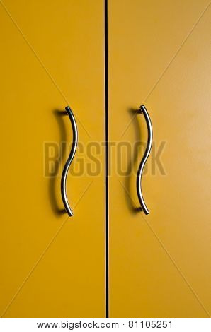 Colored door with two metal handles