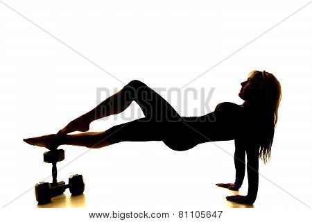 Silhouette Of A Fitness Woman Body Up On Weights Toes On Ankle