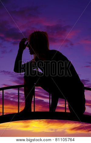 Silhouette Of A Woman Crouched Down Hand By Head