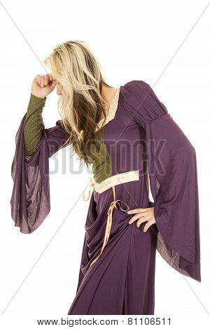 Woman In A Purple Dress Hand On Head Look Down Side