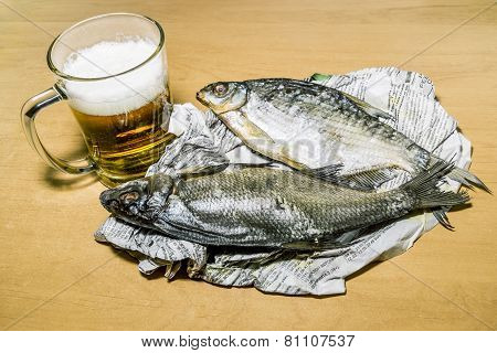 Mug With Beer And Dried Fish At The Newspaper