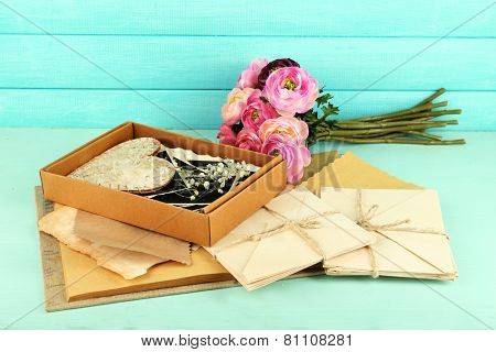 Vintage memories with flowers on wooden background