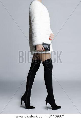 Slender Female Legs In Boots Stockings
