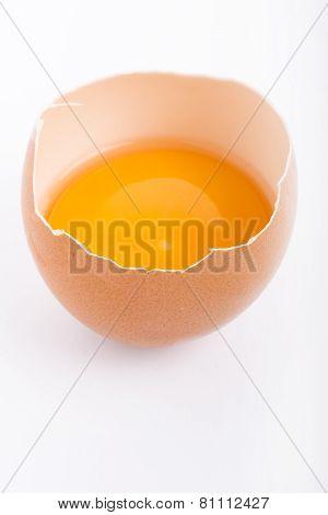 Raw Egg Close-up On White Background