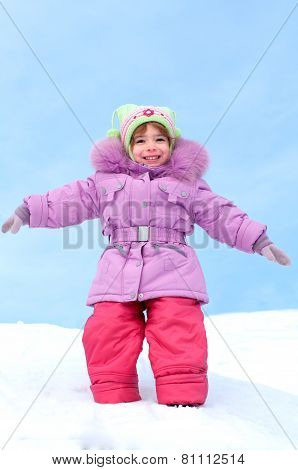 laughing girl dressed in winter clothes