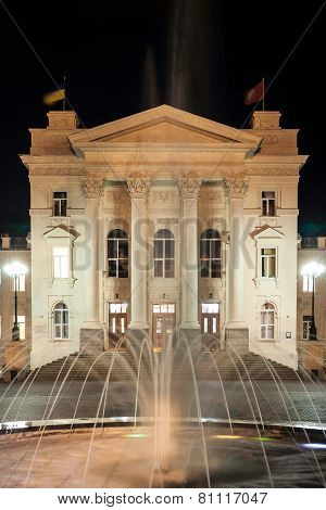Fountain on the background of the historic buildings at night
