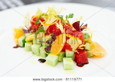 Tuna tartar with cucumber and orange, close-up