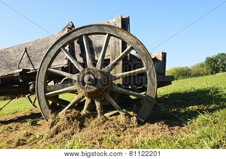 Wooden wheel of an old wagon