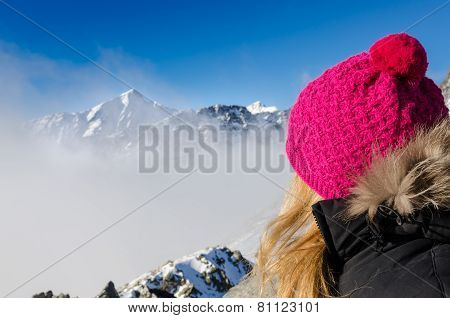 Woman With Colorful Hat Overlooking Winter Mountains