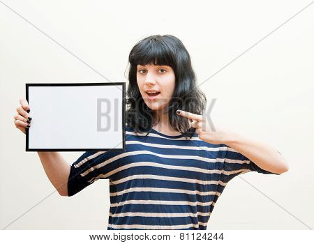 Pretty Brunette Girl Indicating Blank Picture Frame