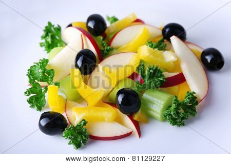 Waldorf salad with olive on plate close up