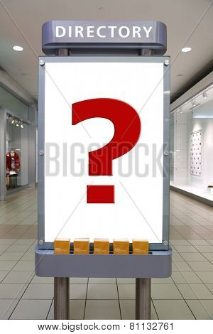 Question mark and direction sign inside shopping mall