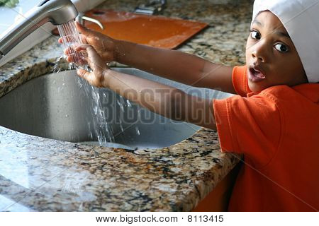 Child Chef Washing His hands