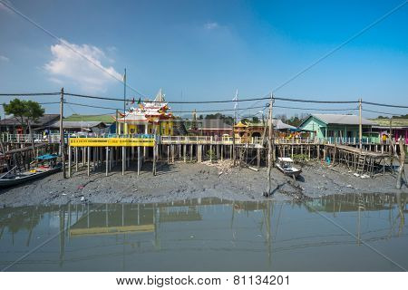 PULAU KETAM, MALAYSIA - JANUARY 18, 2015: A view of a fishermen's village on stilts besides the sea in Pulau Ketam (Crab Island). This island is famous for sea food products and restaurants.