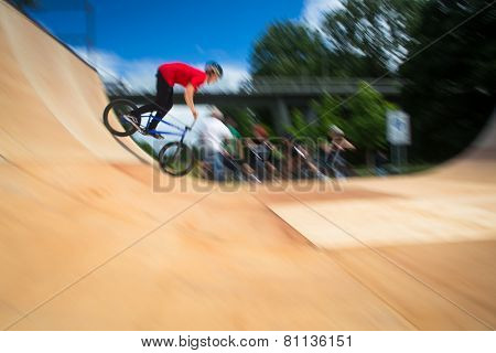 BMX Biker Performing Tricks during ride on a ramp