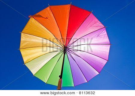Sunblock via colorful rainbow umbrella