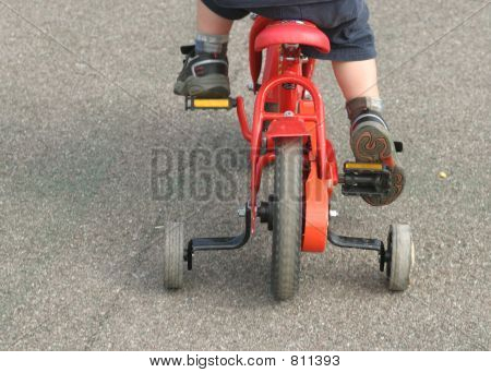 Training Wheels on a red bicycle