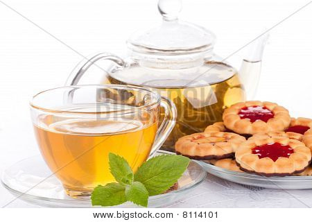 Cup Of Tea  With Mint And Pastries.
