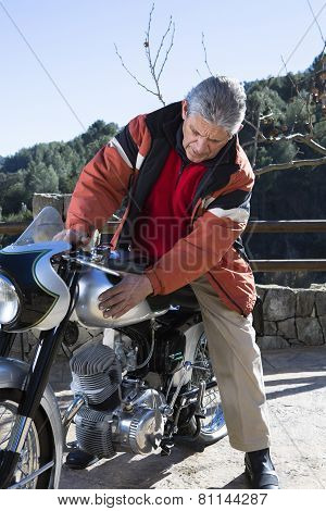 Man Caressing A Motorcycle.