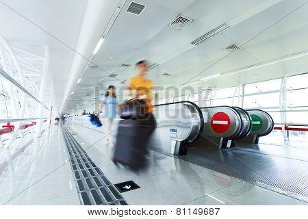 airport corridor and escalator