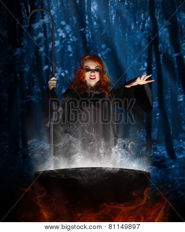 Young witch with cauldron at night forest