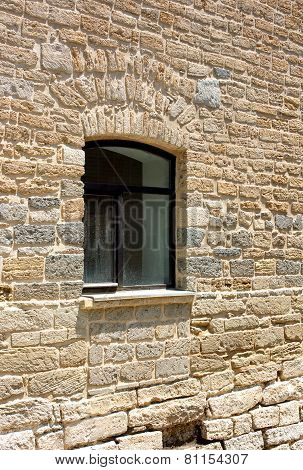 Modern window in the old fortress wall