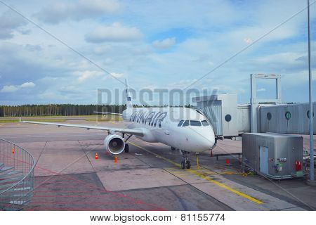 HELSINKI, FINLAND - SEP 03: docked Finnair aircraft on September 03, 2014. Finnair Plc is the flag carrier and largest airline of Finland, with its headquarters in Vantaa