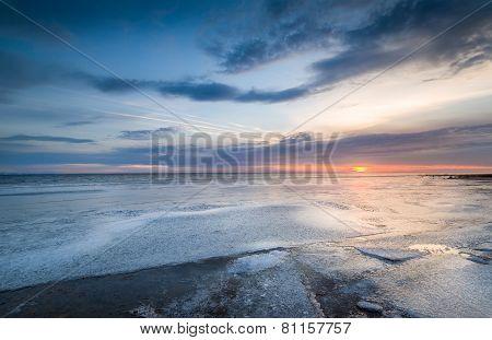 Sunset at frozen sea