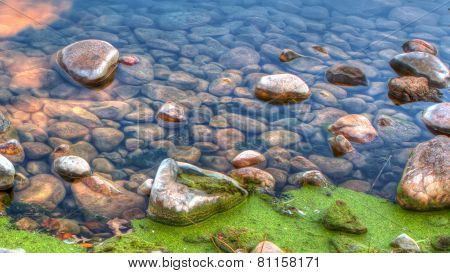 Hdr Of River Edge Rocks In Soft Focus
