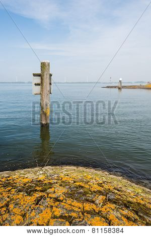 Basalt Stone Pier Covered With Yellow Moss