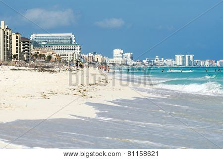 CANCUN - JANUARY 20: Tourists enjoy the sunny weather and relaxing on the beautiful beach on 20 January 2015 in Cancun, Mexico. This is one of the best beaches in the Mexico.