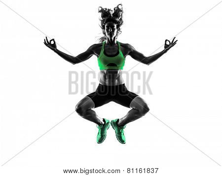 one caucasian woman serene zen   exercising  fitness jumping in studio silhouette isolated on white background