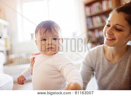Little baby girl playing with her mother