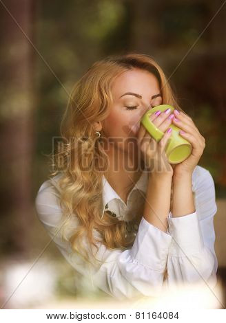 Woman Drinking Coffee Indoors, Enjoying The Aroma Of Beverage, View Through The Window