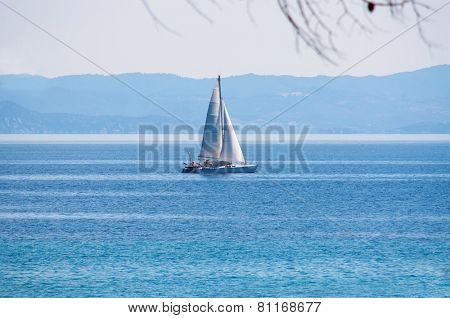 Lonely sailboat on the big blue sea