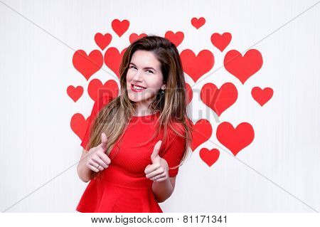 White caucasian woman with red lips giving thumbs up and smiling on heart shaped background.Valentin