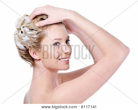 Woman Washing Hair With Shampoo