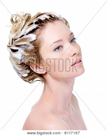 Soaping Woman's Head With Shampoo