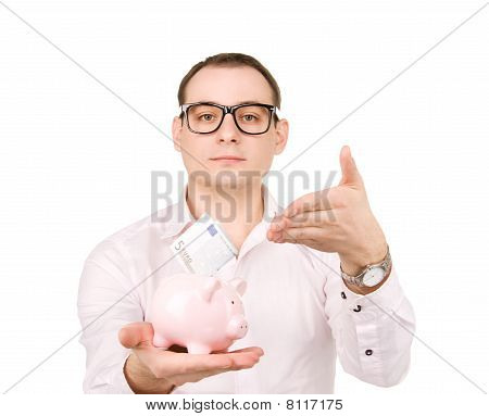 Businessman With Piggy Bank And Money