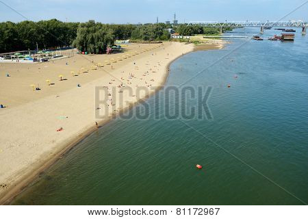NOVOSIBIRSK, RUSSIA - AUGUST 24, 2014: People resting on the beach Nautilus on the left bank of Ob river. It is the main city beach of Siberia's capital