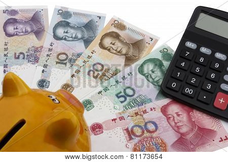 Chinese Money (rmb), Piggy Bank And A Calculator.