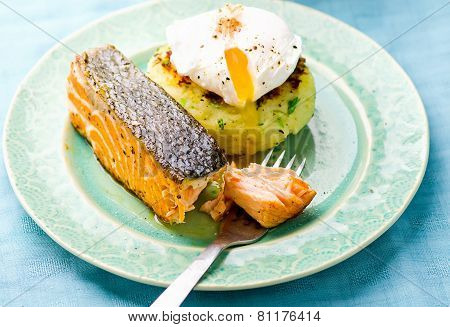 The Fried Salmon With A Potato Patty And Poached Egg