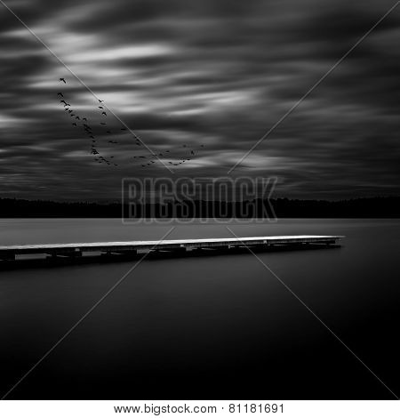 Jetty on a lake in Bavaria, Germany, long time exposure