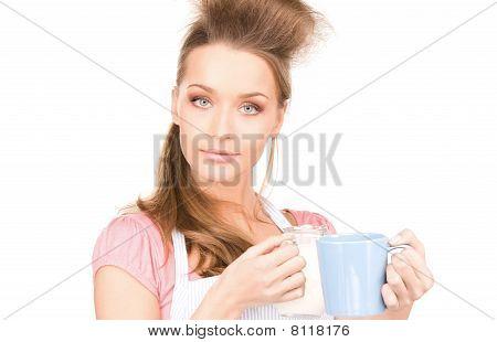 Housewife With Milk And Mug