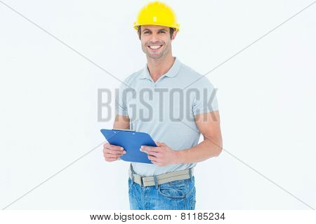 Portrait of happy architect holding clip board over white background