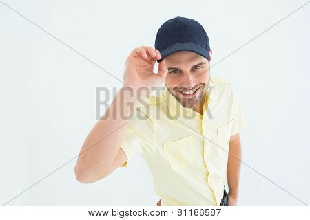 Portrait of handsome delivery man wearing baseball cap on white background