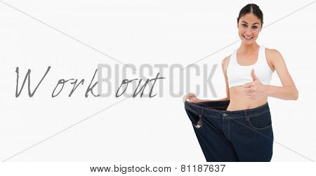Smiling woman who lost a lot of weight the thumbup against white background